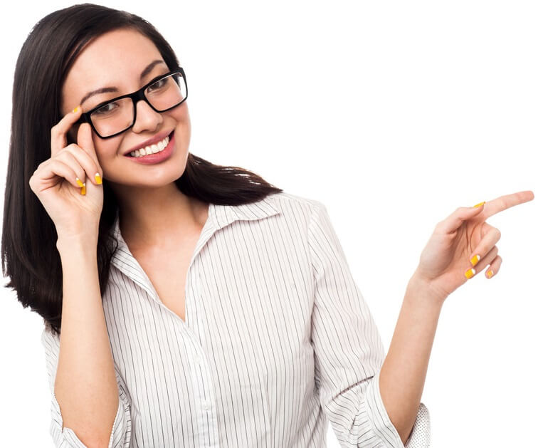 Woman in formal shirt adjusting her eyeglasses and pointing away.